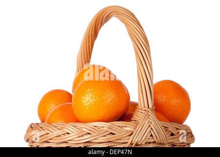 Basket of fresh oranges, mandarines or tangerines isolated on white background - Stock Photo