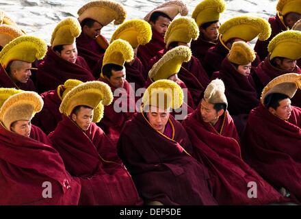 Yellow hats - Gelugpa monks during ceremonies in Labrang monastery in Xiahe - Stock Photo