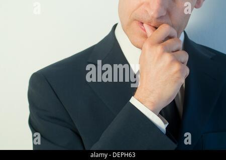 Man biting his nails. Close view. - Stock Photo