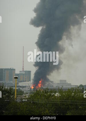 London, UK. 23rd Sep, 2013.  Firefighters tackle a fire at an industrial unit on Midland Terrace, Park Royal, London, - Stock Photo