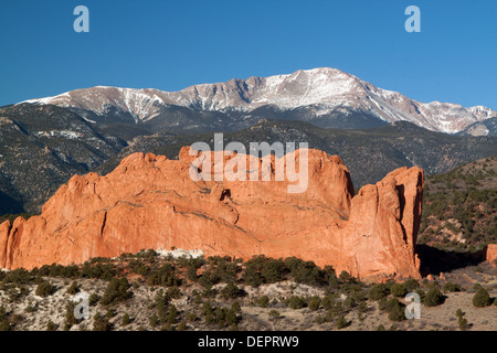 North Gateway Rock at Garden of the Gods Park in Colorado Springs, Colorado, USA, with Pikes Peak in background - Stock Photo