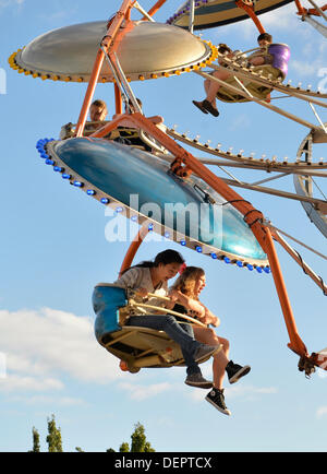 Bellmore, New York, U.S. 22nd September 2013. Two girls scream while riding carnival ride at the 27th Annual Bellmore - Stock Photo