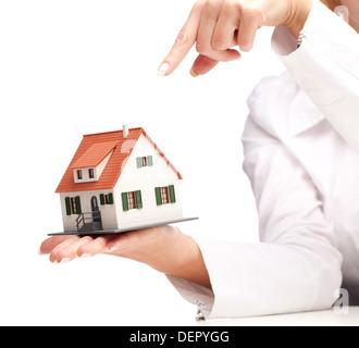 hand holding house isolated on white background - Stock Photo