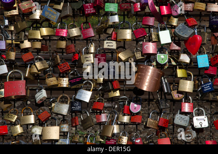 close up of love token padlocks on bridge over the river rhine cologne germany - Stock Photo