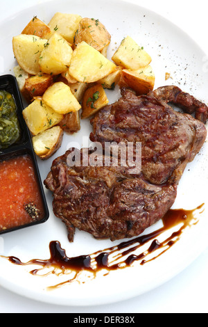 Char Grilled fillet beefsteak with baked potato - Stock Photo