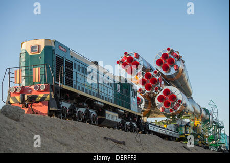 The Russian Soyuz rocket is rolled out to the launch pad by train at the Baikonur Cosmodrome September 23, 2013 - Stock Photo
