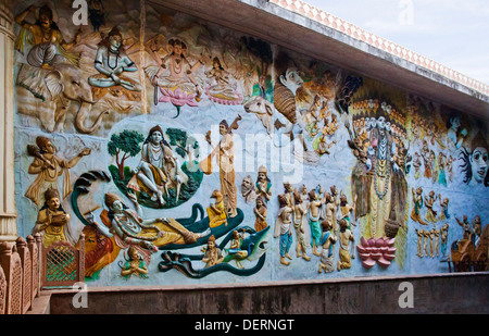 Sculptures of Hindu gods on the wall of a temple, Iskcon Temple, Ahmedabad, Gujarat, India - Stock Photo