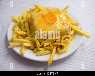 Francesinha - typical sandwich from Oporto, Portugal - Stock Photo