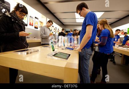 Apple iPhone 5C on sale in the Apple store, Grand Arcade, Cambridge UK - Stock Photo