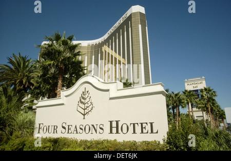 Four Seasons hotel sign and Mandalay Bay hotel and casino. Las Vegas. Nevada, USA - Stock Photo