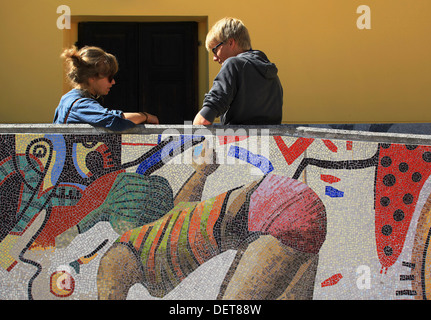 Students of the Friuli School of Mosaics (Scuola Mosaicisti del Friuli) seen in the schoolyard during a break. Spilimbergo,Italy - Stock Photo