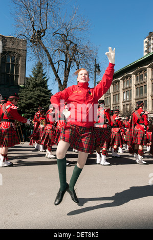 Highland dancer in action during the St Patrick's day parade in Montreal, province of Quebec, Canada. - Stock Photo