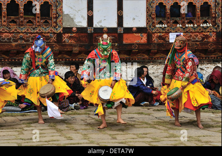 Dancers at Domkhar Tsechu festival held in a monastery in the village of Domkhar, Bumthang, Bhutan - Stock Photo