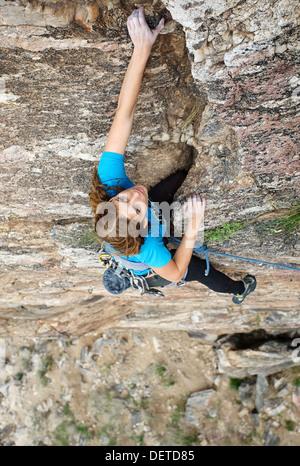 Female rock climber on lead - Stock Photo