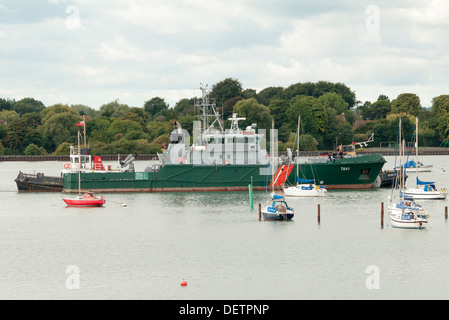 Tavi, large motor yacht being manoeuvred by tugs in Portsmouth Harbour - Stock Photo