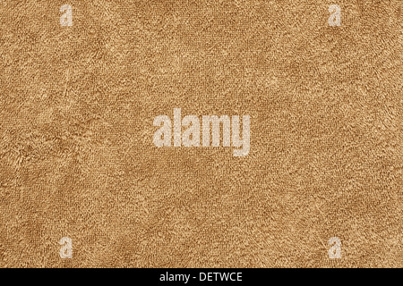 cotton twist towelling background on a beige beach towel - Stock Photo