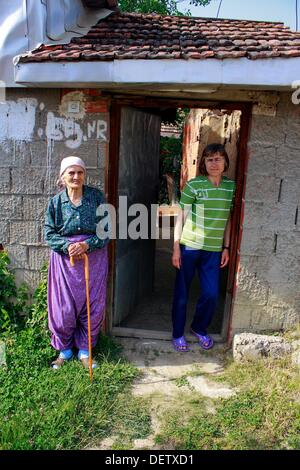 Two kosovar women standing at the door of their house in Prishtina - Stock Photo