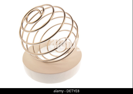 Iron wire tangled up into a spiral ball,lying tilted to the left on a white ring - Stock Photo