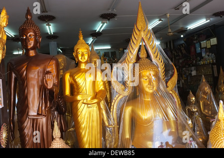 Buddha statues for sale on Bamrung Muang Road in Bangkok, Thailand - Stock Photo