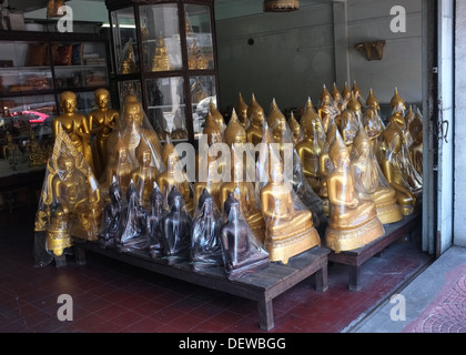 Buddha statues for sale on Bamrung Mueang Road, Bangkok, Thailand - Stock Photo