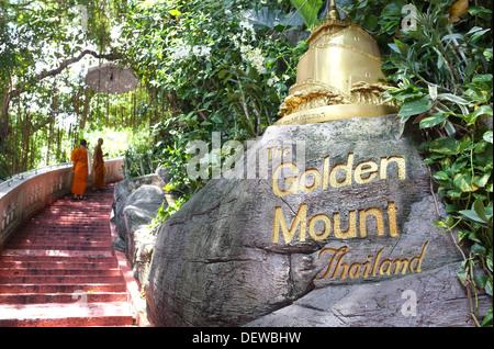 Two Buddhist monks climb the steps to the Golden Mount (Wat Saket), Bangkok Thailand - Stock Photo