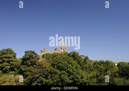 View over trees to ruins of Corfe Castle , Corfe  Isle of Purbeck Dorset England - Stock Photo
