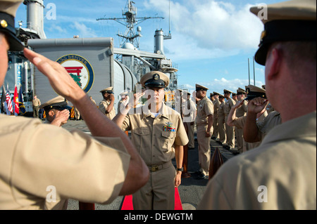 Newly frocked Chief Hospital Corpsman Jose R. Rayos salutes the commanding officer and command master chief at the - Stock Photo
