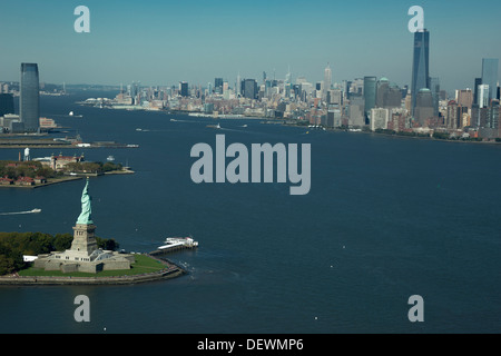 AERIAL STATUE OF LIBERTY DOWNTOWN SKYLINE NEW YORK HARBOR NEW YORK CITY USA - Stock Photo