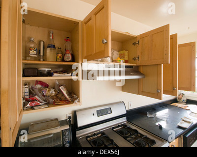 Some packaged foods and products remain in the cabinets of a kitchen inside a foreclosed home in Oakland, California, - Stock Photo
