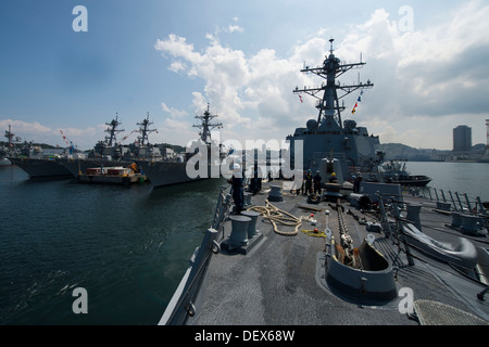 The Arleigh Burke-class guided-missile destroyer USS Preble (DDG 88) pulls away from the pier as the ship gets underway - Stock Photo