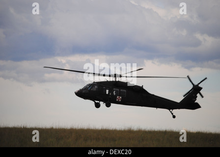 A Wyoming Army National Guard UH-60 Black Hawk takes off to support flood evacuation efforts in Colorado Sept. 14, - Stock Photo