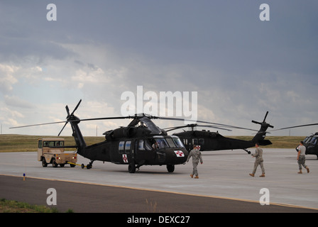 A Wyoming Army National Guard UH-60 Black Hawk prepares to take off to support flood evacuation efforts in Colorado - Stock Photo
