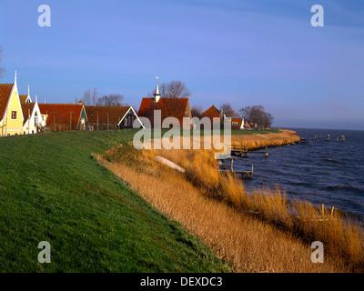 behind dike enclosing markenmeer uitdam village waterland district holland - Stock Photo