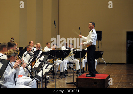 The U.S. 7th Fleet Band, conducted by Lt. Geordie Kelly, 7th Fleet bandmaster, performs at the Yokosuka Arts Theatre. - Stock Photo