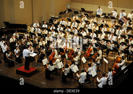 The U.S. 7th Fleet Band, conducted by Lt. Geordie Kelly, 7th Fleet bandmaster, performs with the Yokosuka Symphony - Stock Photo