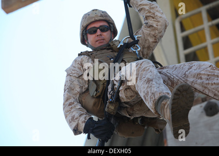 A Marine with 1st Air Naval Gunfire Liaison Company, rappels from a tower during Exercise Burmese Chase 2013, a - Stock Photo