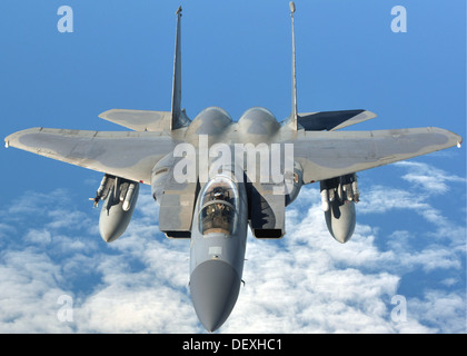 An U.S. Air Force F-15C Eagle prepares to refuel with a U.S. Air Force KC-135R Stratotanker Sept. 12, 2013, en route - Stock Photo
