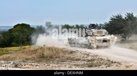 A U.S. Army M1A2 Abrams tank assigned to Delta Company, 1st Battalion, 12th Cavalry Regiment, 3rd Brigade Combat - Stock Photo