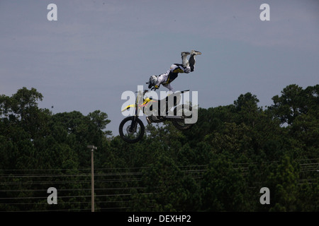 Dustin Miller, freestyle motocross rider, performs a superman seat grab trick for service members and families during - Stock Photo