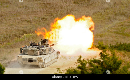 A U.S. Army M1A2 Abrams tank crew assigned to the 1st Battalion, 12th Cavalry Regiment, 3rd Brigade Combat Team, - Stock Photo