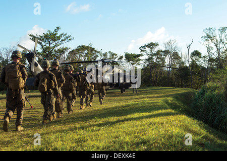 Marines make their way to a U.S. Army UH-60 Black Hawk helicopter Sept. 12 at Camp Schwab as part of the Exercise - Stock Photo