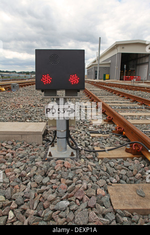 Newly installed Ground Position Signal (GPS) on depot, displaying two red L.E.D. lights to stop trains at this point. - Stock Photo