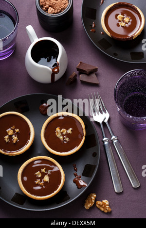tartelettes with chocolate ganache and walnuts - Stock Photo