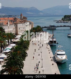 Boats moored on the main promenade in Trogir, Croatia - Stock Photo