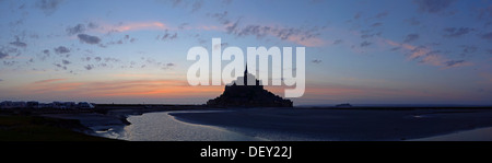 The abbey on top of the rocky island Mont-Saint-Michel seen from the south at sunset, Basse-Normandie, France, Europe - Stock Photo