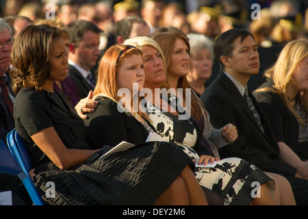 Friends and family of those killed at a Navy Yard shooting look on during a memorial for those killed during a shooting - Stock Photo
