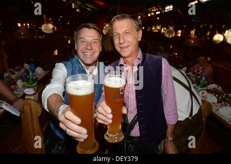 Munich, Germany. 24th Sep, 2013. Folk musician Patrick Lindner (L) and his partner Peter Schaefer at the Promi Wiesn - Stock Photo