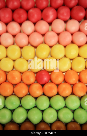 Odd one out, out of place or in the wrong place concepts using coloured sweets - Stock Photo