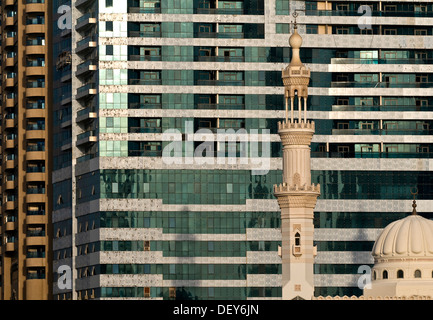 Mosque in front of a high-rise building, Sharjah, United Arab Emirates, Middle East - Stock Photo