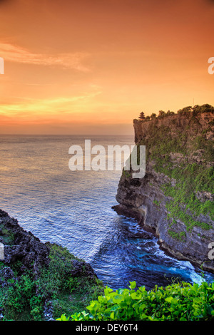 Bali, Bukit Peninsula, Uluwatu, Pura Luhur Uluwatu Temple at sunset, one of the most important directional temples - Stock Photo